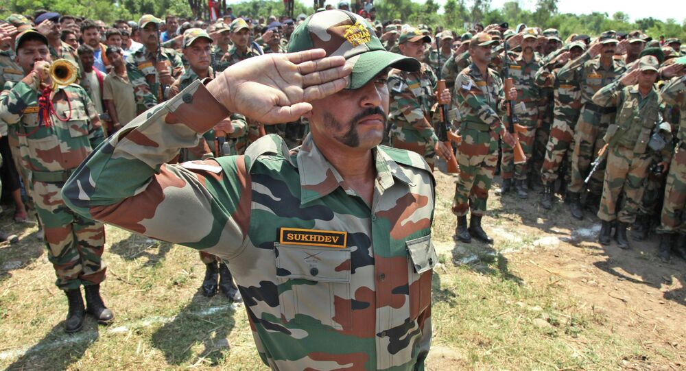 Indian army soldiers pay tribute to their colleague Randeep Singh, who was killed in Thursday's rebel attack in northeastern Manipur state after his body was brought to Akhnoor, Jammu and Kashmir state, India, Sunday, June 7, 2015. A group of rebels using rocket-propelled grenades and automatic weapons ambushed a military convoy in India's insurgency-wracked northeast on Thursday, killing more than a dozen soldiers in the latest major attack in the region in recent months.