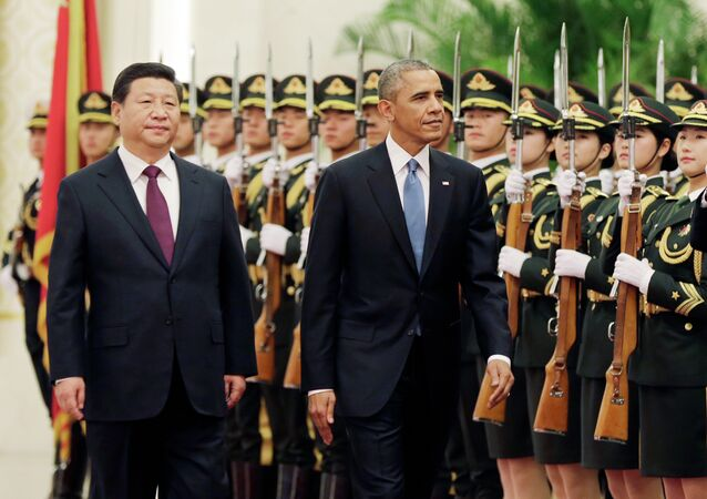 U.S. President Barack Obama and Chinese President Xi Jinping review the honor guard during a welcome ceremony at the Great Hall of the People in Beijing, Wednesday, Nov. 12, 2014.