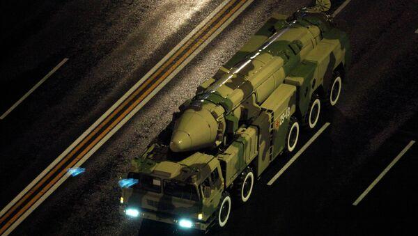 A Chinese military vehicle carries a DF21 medium range ballistic missile. - Sputnik International