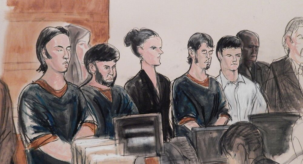 In this courtroom sketch, the four men accused of plotting to send U.S. residents overseas to fight for the Islamic State, Akhror Saidakhmetov, left, Abror Habibov, second from left, Abdurasul Hasanovich Juraboev, fourth from left, and Dilkhayot Kasimov, fifth from left, appear in a New York City courtroom