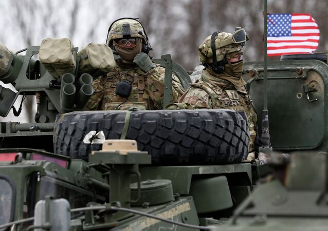 Members of US Army's 2nd Cavalry Regiment ride on an armored vehicle