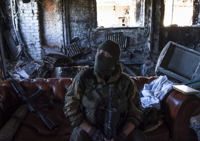 Donbass militiaman rests at his position inside the Donetsk airport, eastern Ukraine. June 9, 2015.