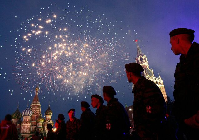Russian soldiers watch fireworks over the Red Square in Moscow during a concert devoted Russia Day 12 June