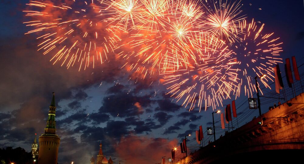 Fireworks explode over the Kremlin, with St. Basil's cathedral, center, marking the Day of Russia in Moscow, Russia, Friday, June 12, 2009