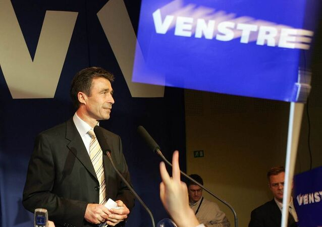 Anders Fogh Rasmussen (R) stands on stage facing supporters at his Venstre Party election headquarters in Copenhagen 08 February 2005.