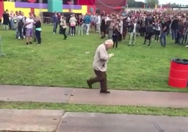 Old man dances at electronic music festival