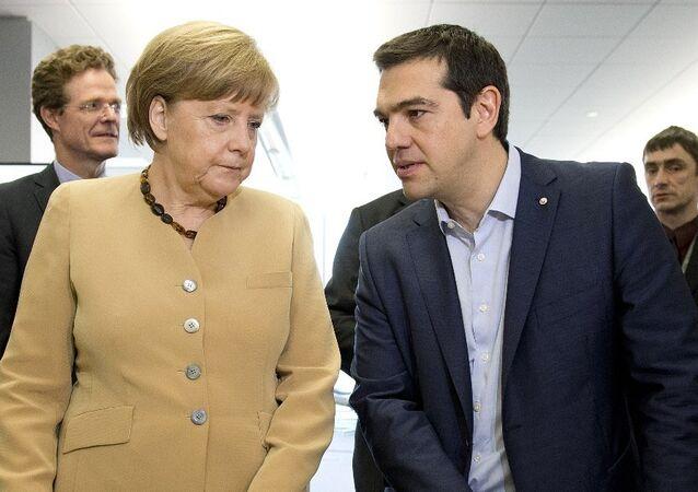 German federal chancellor Angela Merkel, talks with Greek prime minister Alexis Tsipras