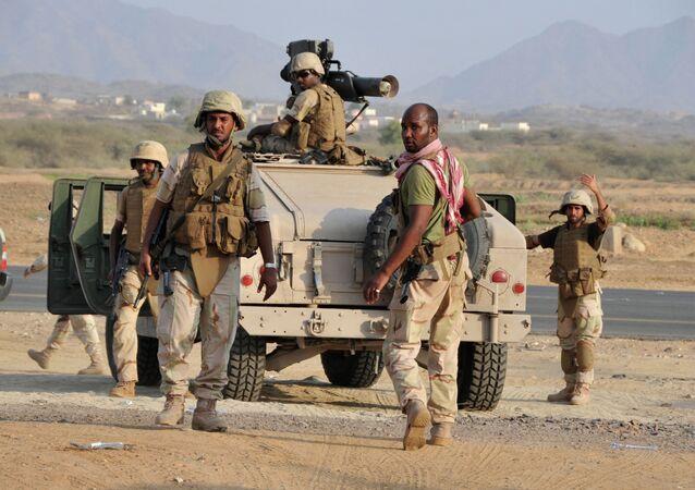 Saudi soldiers standing near the Yemeni border.
