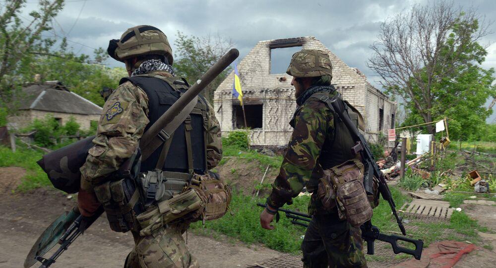 Servicemen walk on May 28, 2015 around Ukrainian positions on the frontline facing eastern Ukrainian independence supporters near Donetsk in eastern Ukraine
