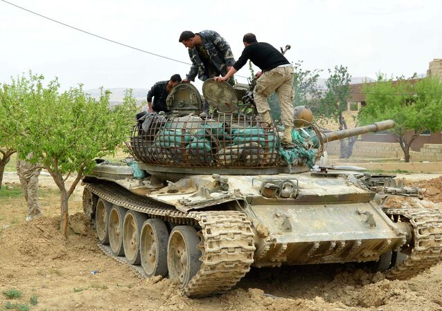 Syrian pro-government  forces check a tank