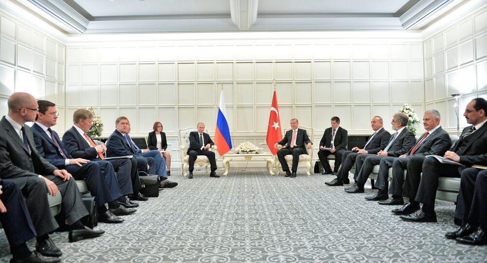 June 13, 2015. Center, from left: Russian President Vladimir Putin and President of Turkey Recep Tayyip Erdogan during a meeting at Four Seasons Hotel Baku, in Baku, Azerbaijan.