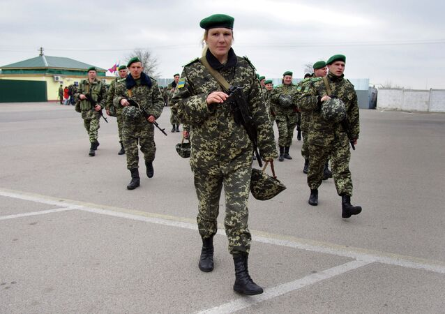 Ukrainian border guards march to patrol at the check point of Kuchurgany, some 100 km from the Black Sea city of Odessa, on the border with Transnistria