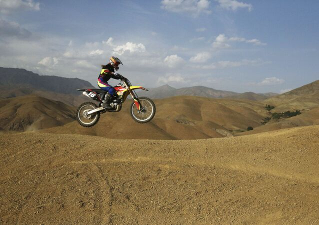 Iranian Behnaz Shafiei rides her motocross bike during her training session at a racetrack in the Alborz mountain range near the village of Baraghan, some 19 miles (30 kilometers) west of the capital Tehran, Iran
