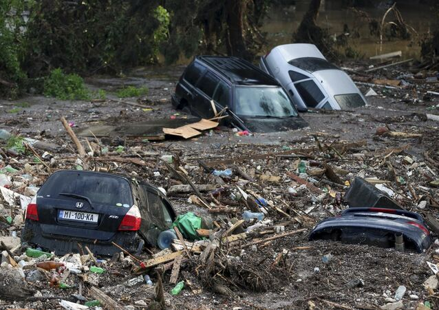Cars are seen among debris at a flooded street in Tbilisi, Georgia, June 14, 2015.