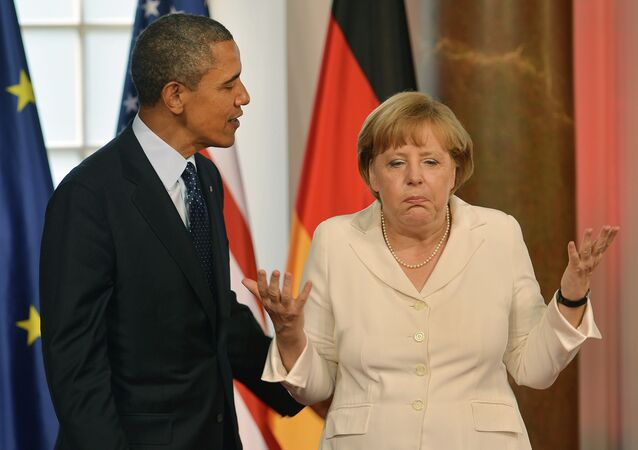 German Chancellor Angela Merkel gestures next to US President Barack Obama