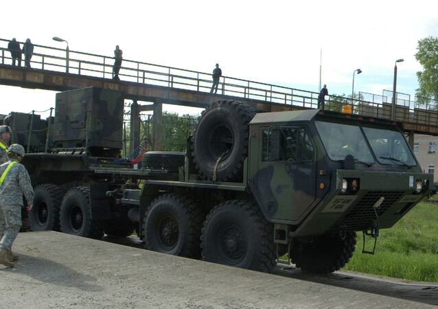 Soldiers watch a US Patriot missile being unloaded in a Polish Army military unit in Morag, northern Poland