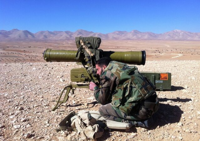 A Syrian soldier aims a rocket launcher towards rebel locations in the Qalamoun region