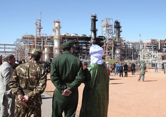 Algerian soldiers and officials stand in front of the gas plant in Ain Amenas. (File)