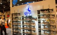 A wall of Colt M4 Carbines in various configurations are displayed at the National Rifle Association (NRA) Annual Meetings and Exhibits on April 14, 2012 in St. Louis, Missouri