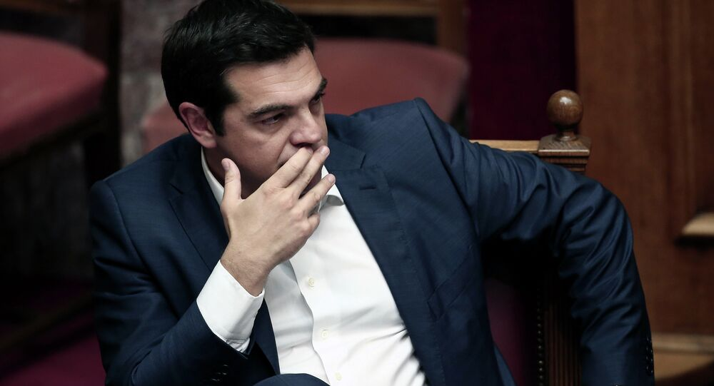 Greek Prime Minister Alexis Tsipras looks on within his address to the Greek Parliament in Athens on June 5, 2015