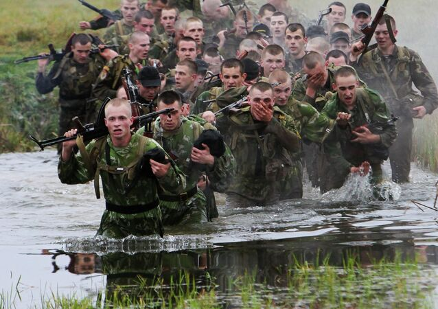 Belarusian special operations soldiers overcoming an obstacle course during qualification competitions for the right to wear maroon berets, the Belarus Interior Ministry's trianing center outside Minsk