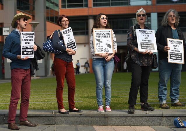 Protesters hold up placards at a rally in Sydney