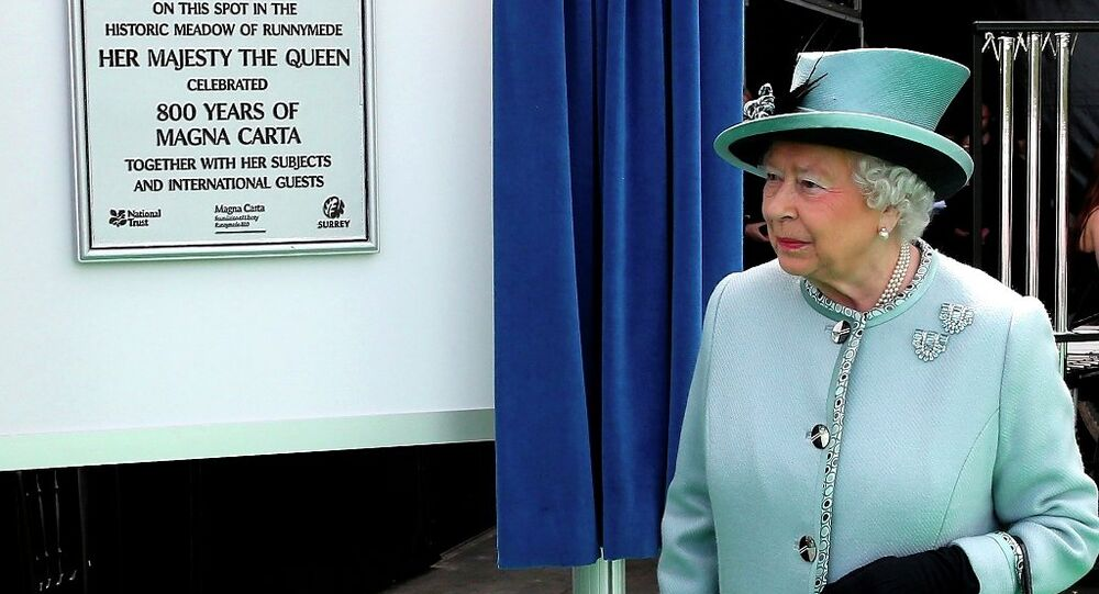 Britain's Queen Elizabeth II unveils a plaque at Runnymede, England, during a commemoration ceremony Monday June 15, 2015, to celebrate the 800th anniversary of Magna Carta.