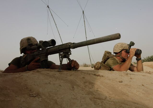 US Marine Corps snipers look for the enemy during an exchange of fire with Taliban militants in Afghanistan in August 2011.