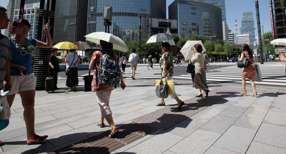 People use parasols to keep from scorching heat in Tokyo