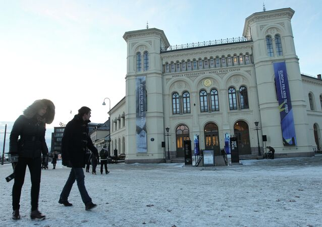 People walk past the Nobel Peace center in Oslo, Norway, Sunday Dec. 9, 2012