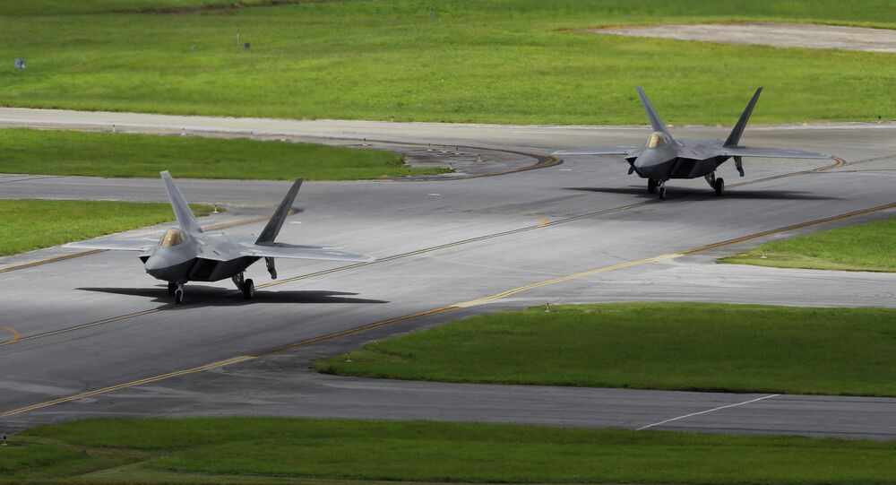 In this August 14, 2012 photo, two US Air Force F-22 Raptor stealth fighters taxi before take-off at Kadena Air Base on the southern island of Okinawa in Japan