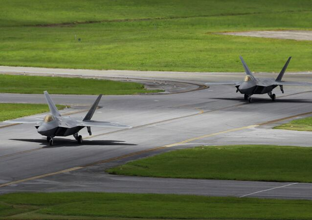 In this Aug. 14, 2012 photo, two U.S. Air Force F-22 Raptor stealth fighters taxi before take-off at Kadena Air Base on the southern island of Okinawa in Japan