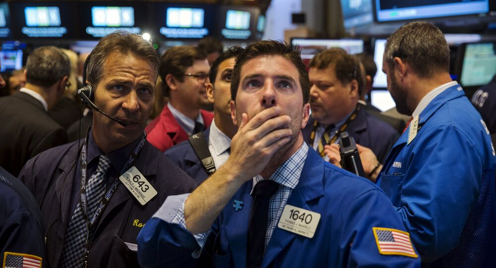Traders work on the floor of the New York Stock Exchange shortly after the opening bell, June 15, 2015