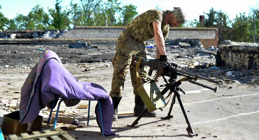 Serviceman of Ukrainian volunteers battalion of Donbass prepares a machine gun on the positions near the village of Shirokine, Donetsk region on June 6, 2015