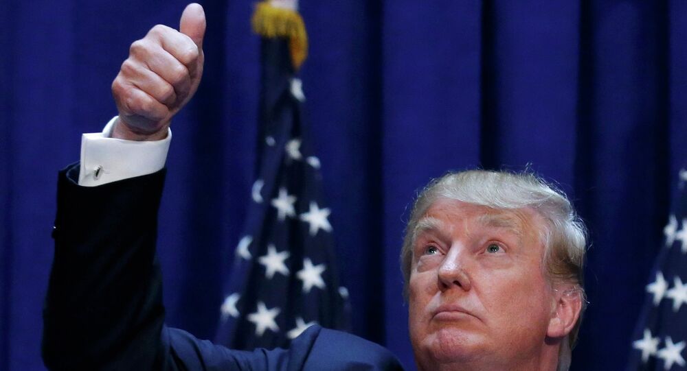 US Republican presidential candidate, real estate mogul and TV personality Donald Trump acknowledges supporters while formally announcing his campaign for the 2016 Republican presidential nomination during an event at Trump Tower in New York June 16, 2015