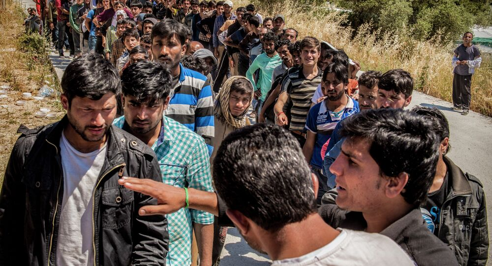 Refugees from Afghanistan are pictured on the island of Lesbos near Moria