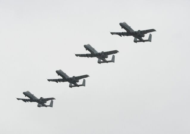 Four A-10 Warthogs from the Selfridge Air National Guard Base fly in formation.