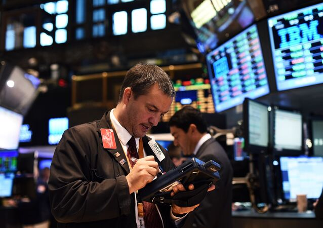 A trader works on the floor of the New York Stock Exchange (NYSE) on October 17, 2014 in New York