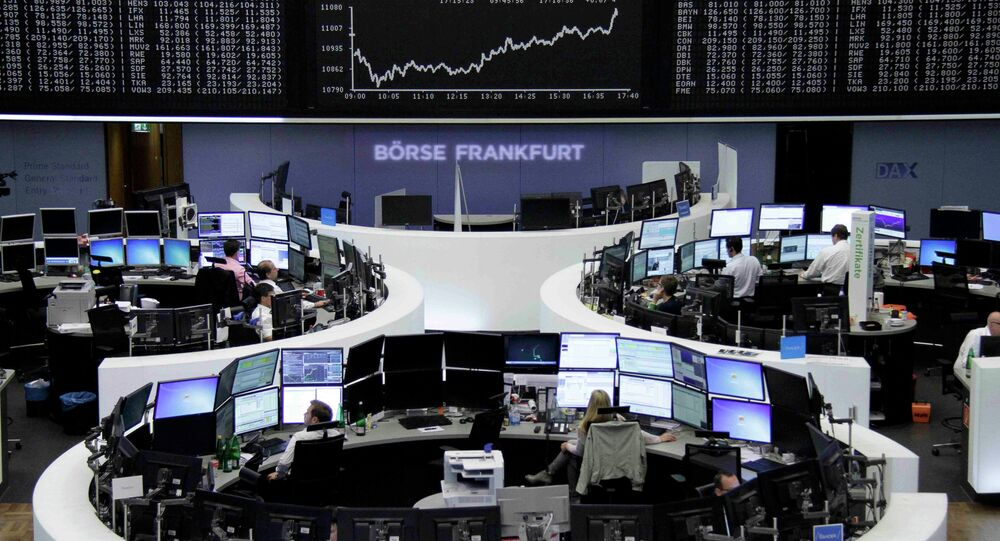 Traders work at their screens in front of the German share price index DAX board at the stock exchange in Frankfurt, Germany June 16, 2015