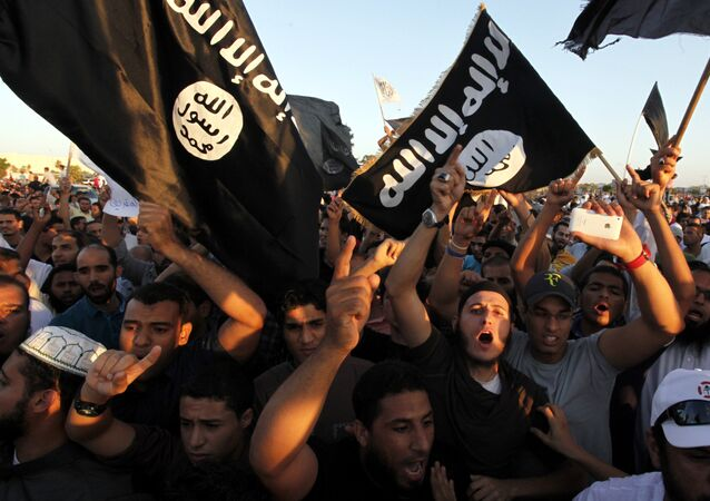 In this Sept. 21, 2012 file photo, Libyan followers of Ansar al-Shariah Brigades and other Islamic militias, hold a demonstration against a film and a cartoon denigrating the Prophet Muhammad in Benghazi, Libya