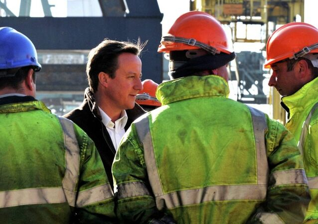 British PM David Cameron talks to dock workers at the Port of Tilbury, Essex