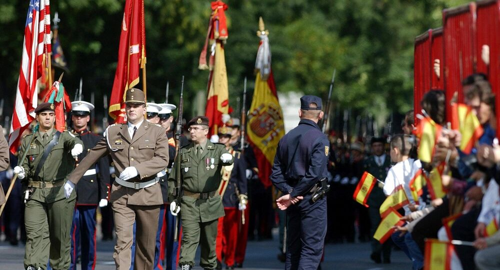 United States and NATO soldiers parade with Spanish armed forces during the National Day Parade in Madrid