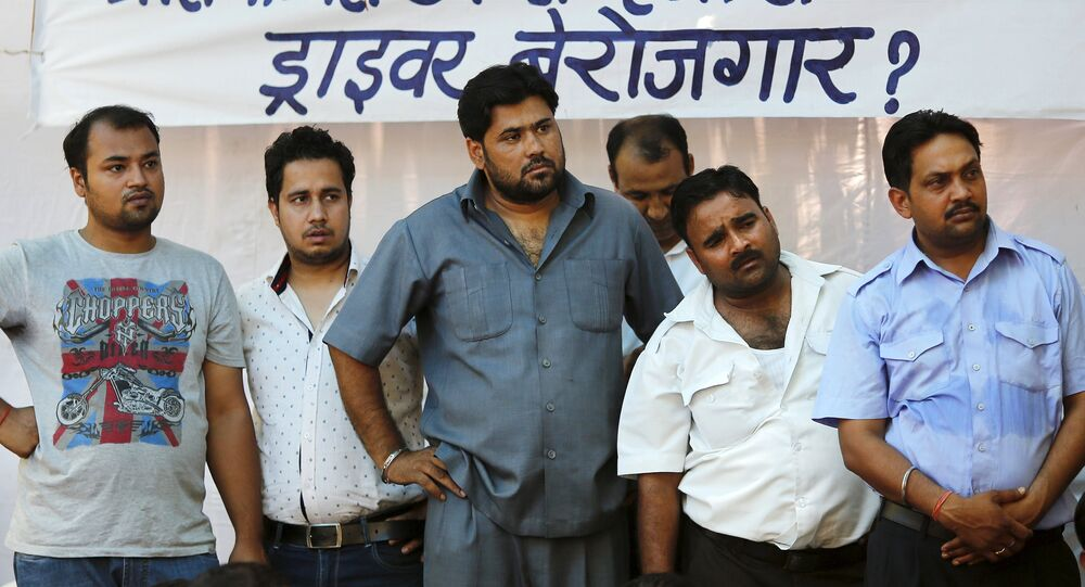 Taxi-drivers listen to a speaker during a protest in New Delhi, India, June 8, 2015