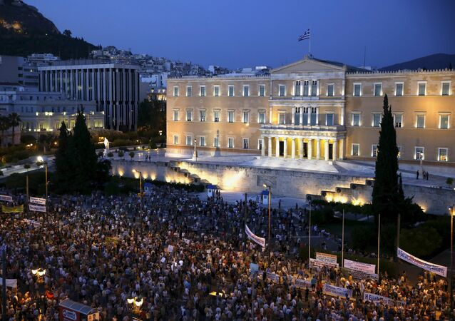 Protesters gather in front of the parliament during a pro-government rally calling on Greece's European and International Monetary creditors to soften their stance in the cash-for-reforms talks in Athens, June 17, 2015.