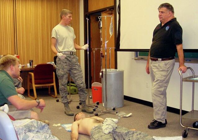 Dr. John Hagmann, right, teaches a course in treating battlefield trauma in this handout photograph taken around 2010 and released on June 17, 2015.
