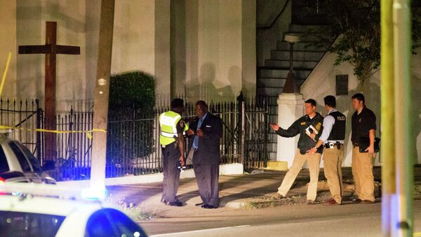 Police stand outside the Emanuel AME Church following a shooting Wednesday, June 17, 2015, in Charleston, S.C. - Sputnik International
