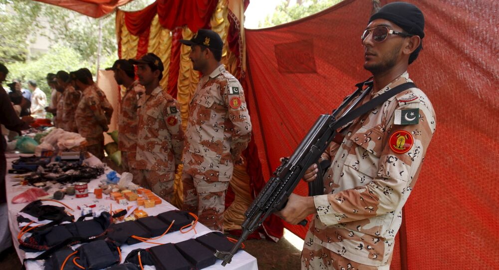 Paramilitary Soldiers display weapons and materials used in making bombs, seized during an operation, during a press briefing at Rangers Headquarter Karachi, Pakistan, May 26, 2015