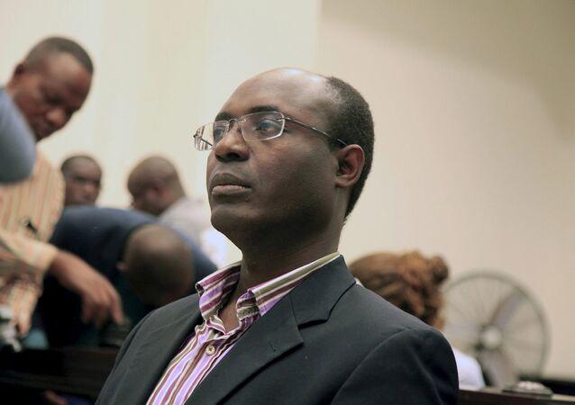 Journalist Rafael Marques de Morais sits in court in Luanda, Angola, May 28, 2015
