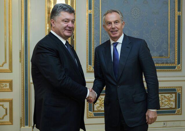 Ukrainian President Petro Poroshenko , left, and former British Prime Minister Tony Blair shake hands during their meeting in Kiev, Ukraine, Wednesday, June 17, 2015