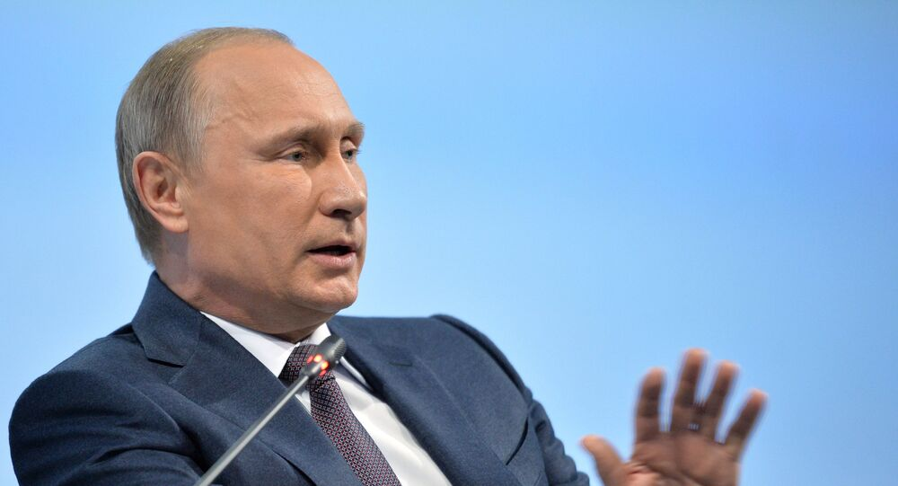 June 19, 2015. Russian President Vladimir Putin at a panel discussion during the plenary meeting of the 19th St. Petersburg International Economic Forum 2015.